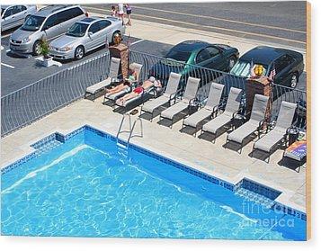 Motel Pool And Surroundings Wood Print by Susan Stevenson