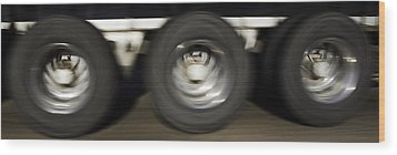 Moving Wheels Wood Print by Miguel Capelo