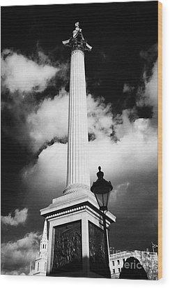 nelsons column in Trafalgar Square London England UK United kingdom Wood Print by Joe Fox