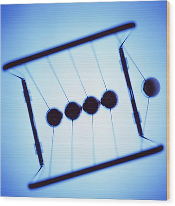 Newton's Cradle Wood Print by Kevin Curtis