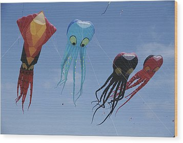 Octopus And Squid-shaped Kites Fly Wood Print by Stephen Sharnoff