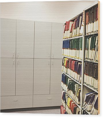 Office Cabinets And Colorful Files Wood Print by Jetta Productions, Inc