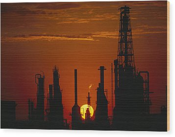 Oil Refinery Silhouetted Wood Print by Paul Chesley