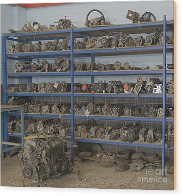 Old Automobile Parts On Shelves Wood Print by Noam Armonn