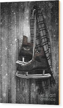 Old Ice Skates Hanging On Barn Wall Wood Print by Sandra Cunningham
