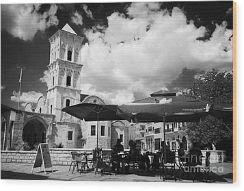 onstreet cafes at St Lazarus Church with belfry larnaca republic of cyprus europe Wood Print by Joe Fox