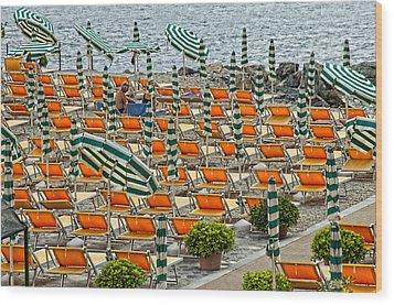 Orange Beach Chairs  Wood Print by Mauro Celotti