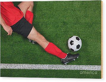 Overhead Football Player Sliding Wood Print by Richard Thomas