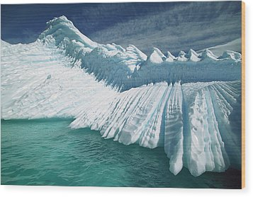 Overturned Iceberg With Eroded Edges Wood Print by Colin Monteath