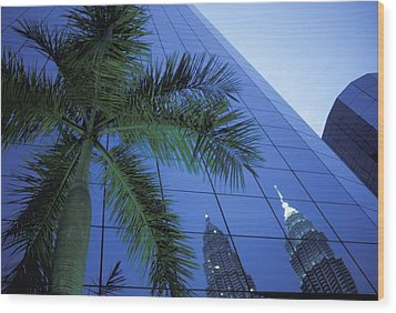Palm Tree And Reflection Of Petronas Wood Print by Axiom Photographic