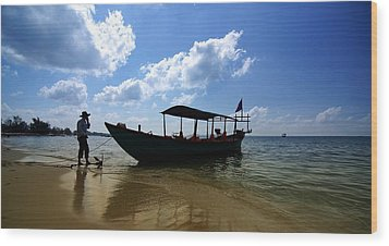 People And Boat Wood Print by Arik S Mintorogo