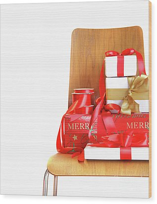 Pile Of Gifts On Wooden Chair Against White Wood Print by Sandra Cunningham