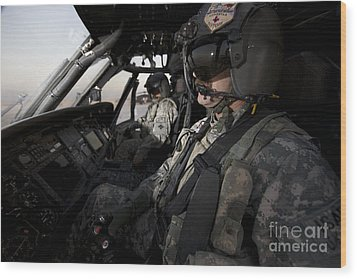 Pilot In The Cockpit Of A Uh-60l Wood Print by Terry Moore