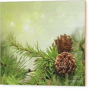 Pine Cones On Branches With Holiday Background Wood Print by Sandra Cunningham