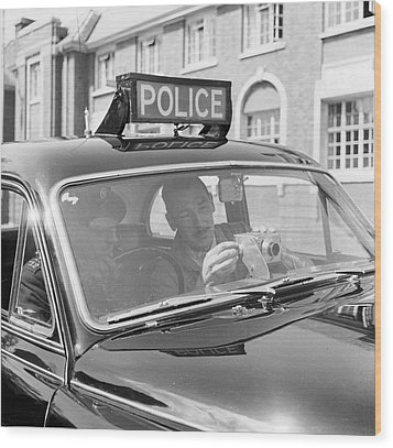 Police Camera Action Wood Print by Ken Harding