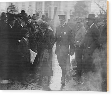 Policeman Leads An Arrested National Wood Print by Everett