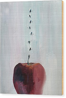 Portrait Of Seven Flies Flying Over An Apple Wood Print by Fabrizio Cassetta