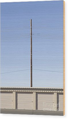 Power Line Pole Over Bay Doors Wood Print by Dave & Les Jacobs
