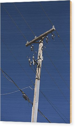 Power Lines Against A Clear Sky Wood Print by John Burcham
