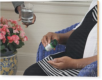 Pregnant Woman Taking Folic Acid Wood Print by Photo Researchers