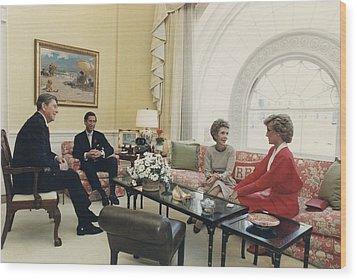 President And Nancy Reagan Having Tea Wood Print by Everett