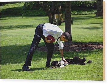 President Barack Obama Pets The Family Wood Print by Everett