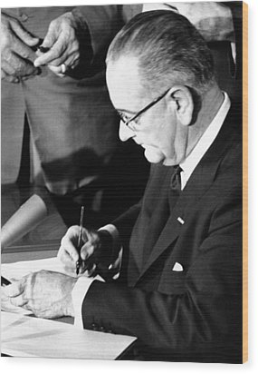 President Lyndon Johnson Signing Wood Print by Everett