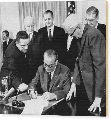 President Lyndon Johnson Signs The 24th Wood Print by Everett