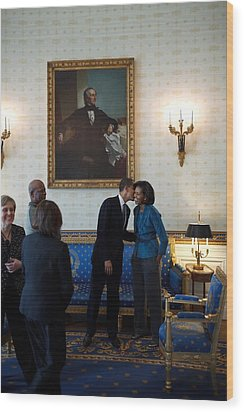 President Obama Kisses First Lady Wood Print by Everett