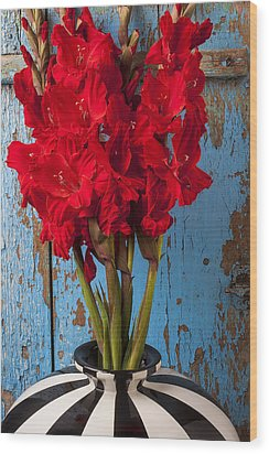 Red Glads Against Blue Wall Wood Print by Garry Gay