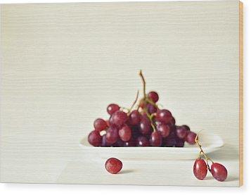 Red Grapes On White Plate Wood Print by Photo by Ira Heuvelman-Dobrolyubova