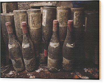 Red Wine Bottles, Covered With Mold Wood Print by James L. Stanfield