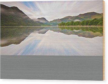 Reflection Of Mountains And Trees On Lake Wood Print by John Ormerod