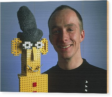Researcher With His Happy Emotional Lego Robot Wood Print by Volker Steger