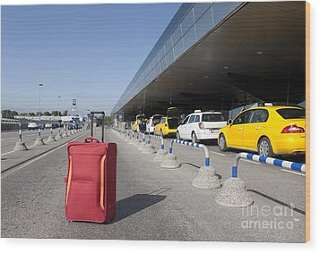 Rolling Luggage Outside An Airport Terminal Wood Print by Jaak Nilson