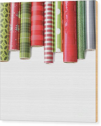 Rolls Of Colored Wrapping  Paper On White3 Wood Print by Sandra Cunningham