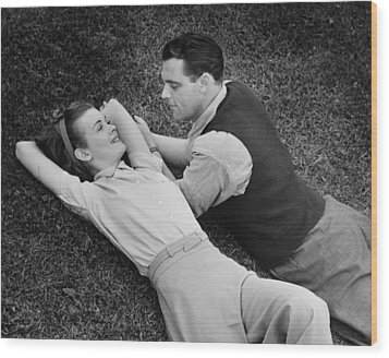 Romantic Couple Lying On Grass, (b&w), Elevated View Wood Print by George Marks