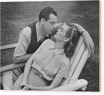 Romantic Couple Relaxing On Deckchair, (b&w) Wood Print by George Marks