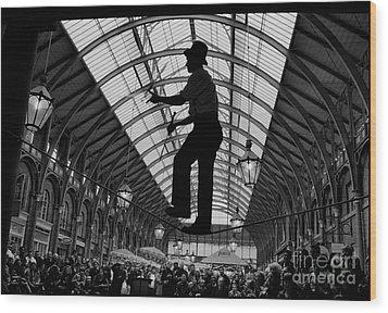Ropewalker In Covent Garden Wood Print by Aldo Cervato