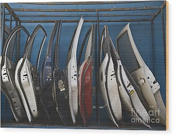 Row Of Dismantled Car Doors Wood Print by Noam Armonn