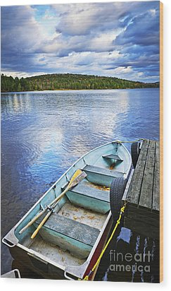 Rowboat Docked On Lake Wood Print by Elena Elisseeva