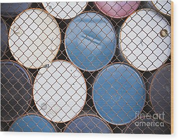 Rows Of Stacked Barrels Behind A Fence Wood Print by Paul Edmondson
