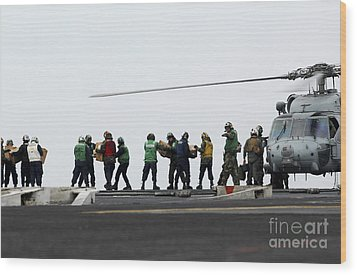 Sailors And Marines Load Supplies Onto Wood Print by Stocktrek Images