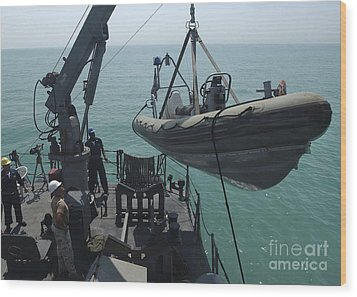 Sailors Lower A Rigid Hull Inflatable Wood Print by Stocktrek Images