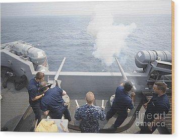 Sailors Perform A 21-gun Salute Aboard Wood Print by Stocktrek Images