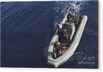 Sailors Stand Watch On A Rigid-hull Wood Print by Stocktrek Images