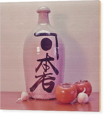 Wood Print featuring the photograph Sake Jug With Persimmon And Garlic by Craig Wood