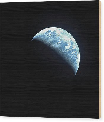 Satellite View Of A Partially Hidden Earth Wood Print by Stockbyte