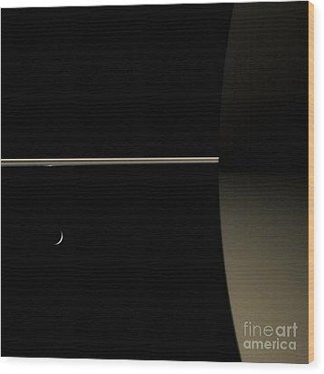 Saturn And Its Moon Tethys Wood Print by NASA/Science Source