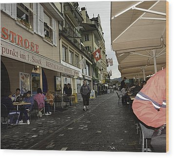 Seated In The Cafe Along The River In Lucerne In Switzerland Wood Print by Ashish Agarwal